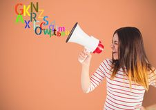 Woman shouting by the megaphone with colour letters coming up from that. Digital composite of woman shouting by the megaphone with colour letters coming up from Royalty Free Stock Photo