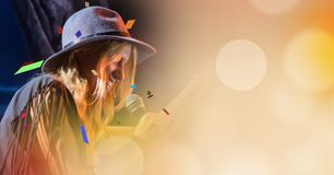 Woman singing at concert with transition Stock Photo