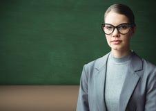 Woman standing with blackboard. Digital composite of Woman standing with blackboard Stock Images