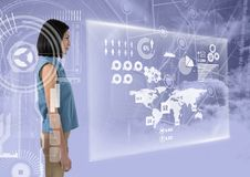 Woman surrounded in interfaces looking forward. Digital composite of Woman surrounded in interfaces looking forward Royalty Free Stock Photos