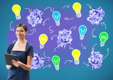 Woman on tablet standing next to light bulbs with crumpled paper balls. Digital composite of Woman on tablet standing next to light bulbs with crumpled paper Royalty Free Stock Photography