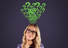 Woman thinking with green question marks. Digital composite of Woman thinking with green question marks Royalty Free Stock Photography