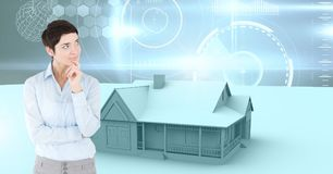 Woman thinking and House with sky interface glowing. Digital composite of Woman thinking and House with sky interface glowing Stock Photo