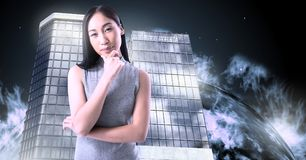 fc2f6ca20d Woman thinking and Tall buildings with planet burning background stock  photos