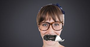 Woman with torn paper on mouth and cartoon mouth. Digital composite of Woman with torn paper on mouth and cartoon mouth Stock Photos
