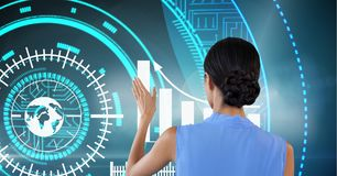 Woman touches graph interface on wall. Digital composite of Woman touches graph interface on wall Royalty Free Stock Photography