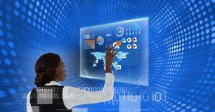 Woman touches screen with binary overlay. Digital composite of Woman touches screen with binary overlay Stock Image