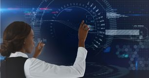 Woman touching dark blue interface. Digital composite of Woman touching dark blue interface Stock Photography