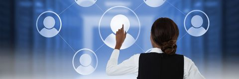 Woman touching user icon interface. Digital composite of Woman touching user icon interface Royalty Free Stock Images