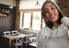 Woman in warm hat and gloves in cafe. Digital composite of Woman in warm hat and gloves in cafe Stock Images