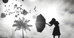 Women holding umbrella silhouette with tropical storm and circles stock images
