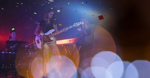 Woman playing guitar at concert with transition Royalty Free Stock Photography
