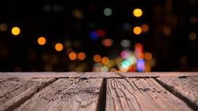 Wooden deck and bokeh. Digital composite of wooden deck with bokeh lights in the background stock video footage