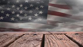 Wooden deck and American flag. Digital composite of a wooden deck with a view of an American flag waving stock video