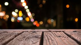 Wooden deck and bokeh. Digital composite of a wooden deck with a view of a blurred background producing bokeh stock video