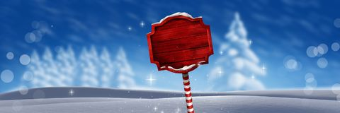 Wooden signpost in Christmas Winter landscape. Digital composite of Wooden signpost in Christmas Winter landscape Stock Photo