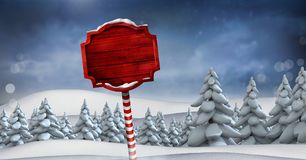 Wooden signpost in Christmas Winter landscape. Digital composite of Wooden signpost in Christmas Winter landscape Royalty Free Stock Photography