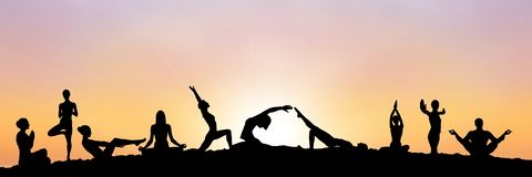 Yoga group silhouette at sunset. Digital composite of yoga group silhouette at sunset Stock Photo