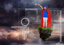 Young Girl superhero on floating rock platform  in sky with interface. Digital composite of Young Girl superhero on floating rock platform  in sky with interface Royalty Free Stock Photos