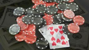 Playing cards and chips with banknotes. Digital composition of playing cards and chips against a rotating view of banknotes on the background stock footage