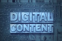 Digital content pc board. Digital content phrase made from metallic letterpress blocks on the pc board background Stock Images