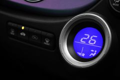 Digital controller air conditioner with blue light in car. Autom Royalty Free Stock Images
