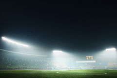 Digital coposit of soccer field and night sky Stock Photos