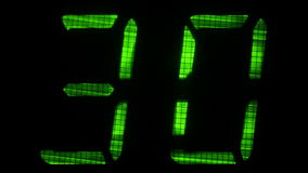 Digital countdown timer with an interval 60 seconds. Green on a black background