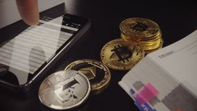 Digital cryptocurrency Bitcoin, Ethereum, Litecoin stock footage
