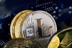 Digital cryptocurrencys Bitcoin, Ethereum, Litecoin on motherboard. Cryptocurrency concept, close-up. Digital cryptocurrencys bitcoin, ethereum and litecoin on royalty free stock images