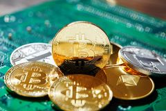 Digital cryptocurrencys Bitcoin, Ethereum, Litecoin on motherboard. Cryptocurrency concept, close-up. Digital cryptocurrencys bitcoin, ethereum and litecoin on stock photo