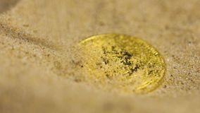 Digital Currency Bitcoin Model Poured with Sand. Macro slow motion first decentralized digital currency bitcoin real model poured with yellow sand stock footage
