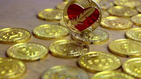 Gold feather coin. Digital currency physical feather coin. Gold background coins concept stock video