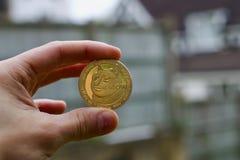 Gold Dogecoin coin Stock Photo