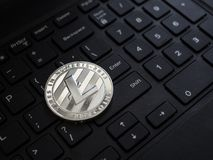 Digital currency physical silver litecoin coin. On white computer keyboard Stock Images
