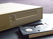 Digital data storage drive and digital tape. In soft light, with activity LED(s) illuminated Stock Image