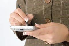 Digital Datebook. Woman's manicured hands writing in digital datebook Royalty Free Stock Image