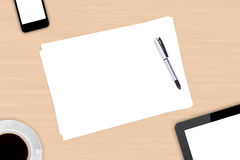 Digital Devices and Blank Papers with Coffee Royalty Free Stock Image