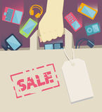Digital devices falling into a paper shopping bag Royalty Free Stock Photos