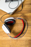 Digital devices and Headphones on a wooden Desktop Royalty Free Stock Photography