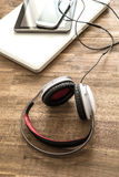 Digital devices and Headphones on a wooden Desktop Stock Images