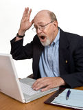 Digital Dilemma. Bad news or a computer glitch results in a senior outburst of dismay royalty free stock image