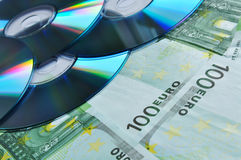 Digital disc on money Stock Photography