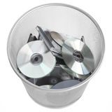 Digital Discs In Dustbin Royalty Free Stock Photos