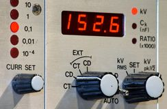 Digital display and control knobs. On the front panel of an electronic measurement device Royalty Free Stock Images