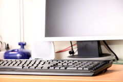 The digital display and keyboard. On a desktop at office Stock Photos