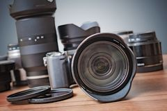 Digital DSLR camera, many lenses, filters and equipment. royalty free stock photo