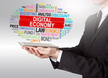 Digital Economy Concept, young man holding a tablet computer Stock Image