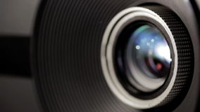 Digital film projector lens in action Stock Photo