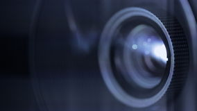 Digital film projector lens in action Royalty Free Stock Images